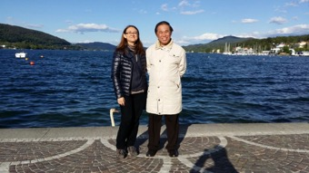 Mariangela and Grandmaster Wong in front of W旦rther Lake with crystal blue wate