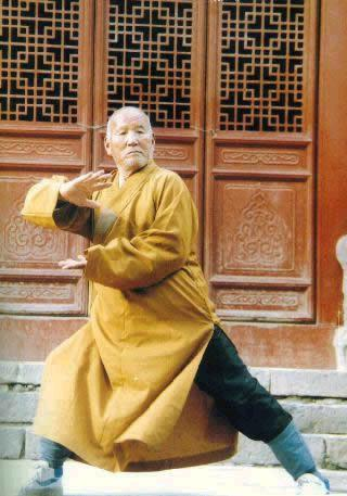 an old monk demonstrating Shaolin Kungfu